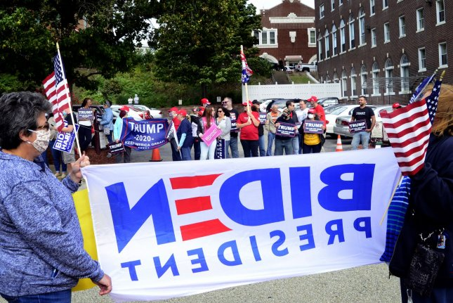 Supporters of President Donald Trump and Democratic nominee Joe Biden rally last Wednesday outside the Greensburg Depot in Greensburg, Pa., a stop on Biden's Build Back Better train tour through Ohio and Pennsylvania. Photo by Archie Carpenter/UPI