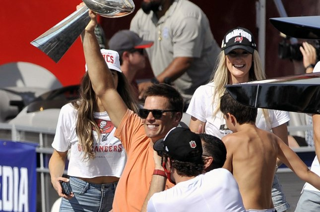 Tampa Bay Buccaneers quarterback Tom Brady (C) holds the Lombardi Trophy as he celebrates their Super Bowl LV win over the Kansas City Chiefs during a boat parade Wednesday down the Hillsborough River in Tampa, Fla. Photo by Steve Nesius/UPI