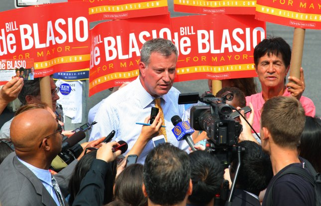 Mayoral candidate Bill de Blasio talks to the media as he campaigns at the 96th Street subway stop on the Upper West Side as the mayoral primary takes place on September 10, 2013 in New York City. De Blasio is leading in the Democratic primary, but it was unclear whether he had enough votes to avoid an Oct. 1 runoff election. UPI /Monika Graff