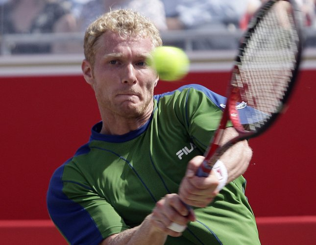 Russian Dmitry Tursunov plays a backhand in his match against Britain's Tim Henman at the Quarter Finals of the 2006 Stella Artois tennis tournament in London on Friday June 16 2006. Henman won the match won the match 6-3 7-6.(UPI Photo/Hugo Philpott)