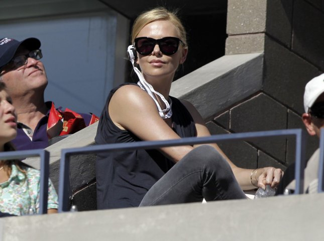Charlize Theron watches a match at the U.S. Open Tennis Championships in Arthur Ashe Stadium in New York City on September 11, 2010. UPI/John Angelillo