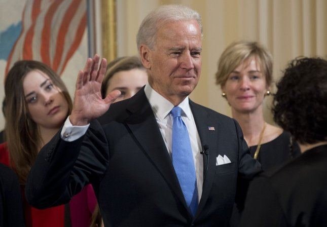 US Vice President Joe Biden takes the oath of office during the 57th Presidential Inauguration official swearing-in ceremony at the Naval Observatory on January 20, 2013 in Washington, DC. The oath is administered by US Supreme Court Justice Sonia Sotomayor. UPI/Saul Loeb POOL