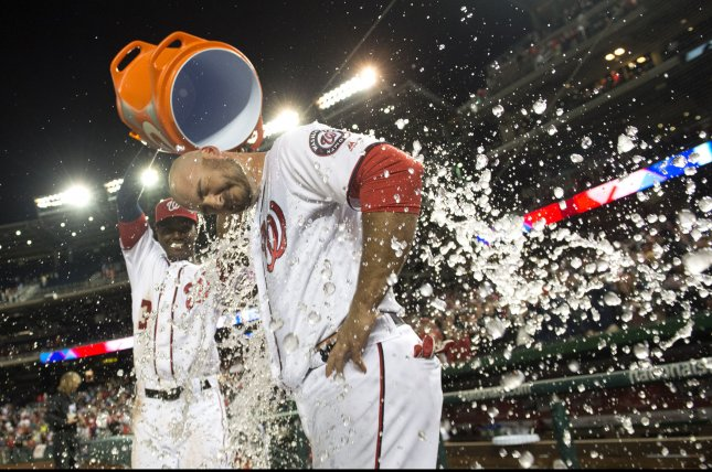 Washington Nationals' Clint Robinson is dunked with water by teammate Michael Taylor after Robinson hit a walk-off game winning home run in the ninth inning against the Detroit Tigers at Nationals Park in Washington, D.C. on May 9, 2016. The Nationals defeated the Tigers 5-4. Photo by Kevin Dietsch/UPI