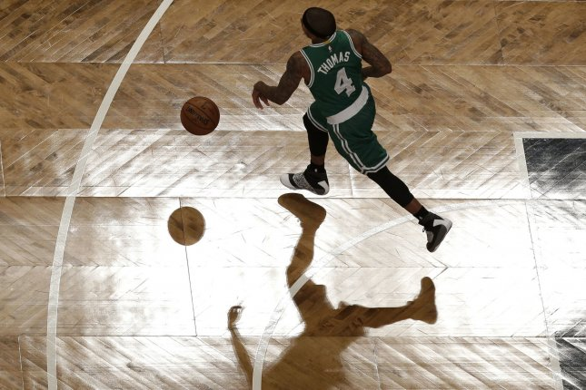 Boston Celtics' Isaiah Thomas tied John Havlicek's 45-year-old Celtics record with his 40th straight 20-point game, scoring 33 and pulling off his usual fourth-quarter heroics in a 116-108 victory over the Philadelphia 76ers on Wednesday night. File Photo by John Angelillo/UPI