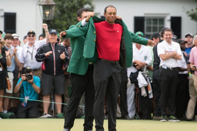Tiger Woods receives the Green Jacket from 2018 Masters Champion Patrick Reed after Woods won the 2019 Masters Tournament at Augusta National Golf Club in Augusta, Georgia, on April 14, 2019. Woods won the tournament 13-under-par. Photo by Kevin Dietsch/UPI
