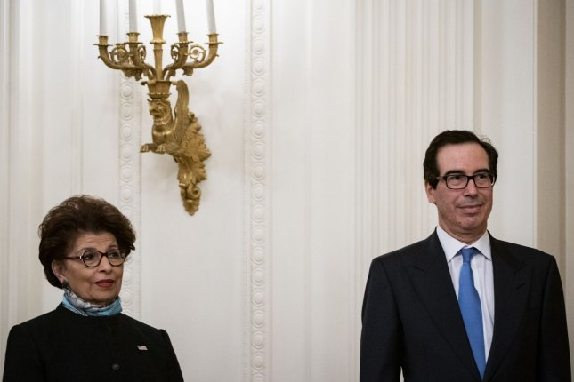 SBA Administrator Jovita Carranza, shown beside Treasury Secretary Steven Mnuchin, said Thursday that $10 billion from the Paycheck Protection Program would be reserved for Community Development Financial Institutions. File Photo by Al Drago/UPI