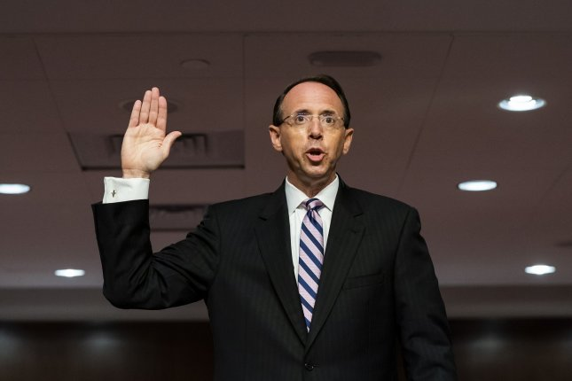 Former Deputy Attorney General Rod Rosenstein is sworn in to testify on Capitol Hill Wednesday before a Senate judiciary committee hearing on Crossfire Hurricane, the FBI's two-year investigation into Russian electoral interference. Photo by Greg Nash/UPI/Pool
