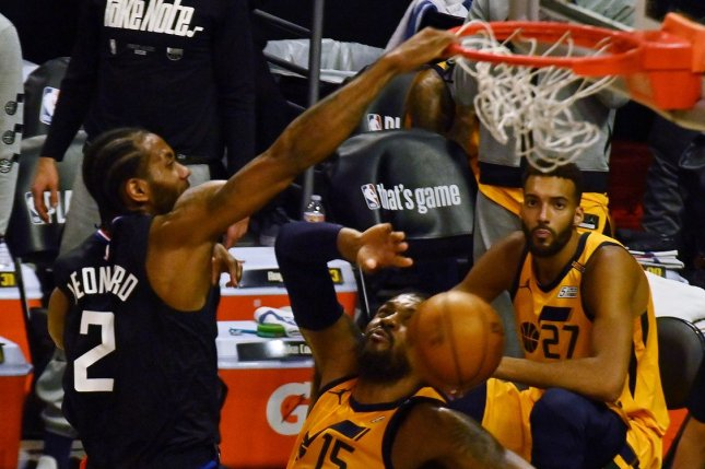 Los Angeles Clippers forward Kawhi Leonard dunks over Utah Jazz defenders in the first half in Game 4 of a Western Conference Semifinals series Monday at Staples Center in Los Angeles. Photo by Jim Ruymen/UPI
