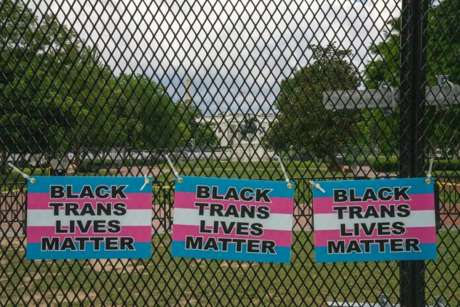 Signs covered a fence blocking Lafayette Park near the White House in Washington during Black Lives Matter protests on June 25, 2020. File photo by Ken Cedeno/UPI
