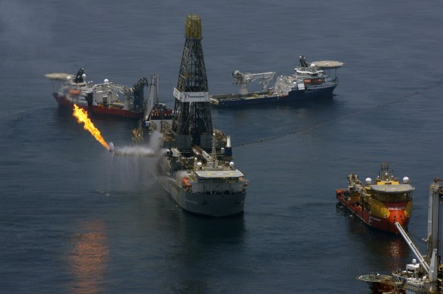 The Transocean Discoverer Enterprise drill ship (with flare) collects oil June 13, 2010, near the site of the BP Deepwater Horizon oil rig explosion. BP continued its attempts to stem the flow of oil from its sunken Deepwater Horizon oil rig, which exploded and sank in the Gulf of Mexico last month. UPI/A.J. Sisco..