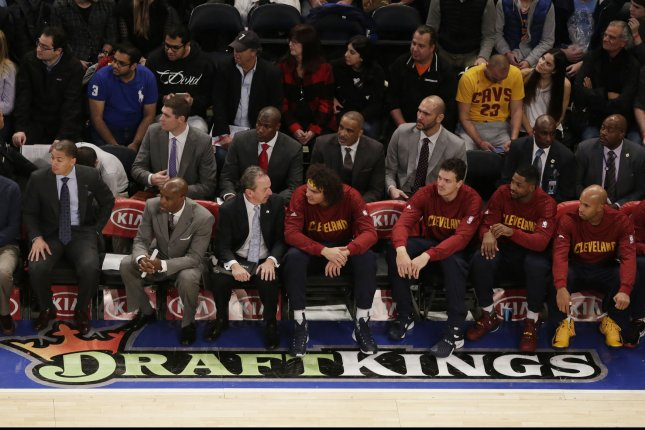 A DraftKings logo is on the court when Cleveland Cavaliers play the New York Knicks at Madison Square Garden in New York City on November 13, 2015. Daily fantasy giants DraftKings and FanDuel each filed a lawsuit Friday in New York State Supreme Court in Manhattan to try to stop New York Attorney General Eric Schneiderman from carrying out his threat to ban daily fantasy games from New York state. Photo by John Angelillo/UPI