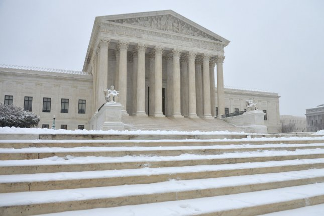 The United States Supreme Court is seen as snow falls Monday in Washington, D.C. With the recent death of Supreme Court Justice Anthony Scalia a political battle has been sparked on whether President Barack Obama should nominate a successor or wait until a new President is in office. Scalia died Saturday at the age of 79. Photo by Kevin Dietsch/UPI