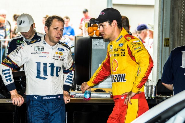 Teammates Brad Keselowski (left) and Joey Logano confer during a break from practice for the 2017 Brickyard 400, at the Indianapolis Motor Speedway on July 22, 2017 in Indianapolis, Indiana. Photo by Edwin Locke/UPI