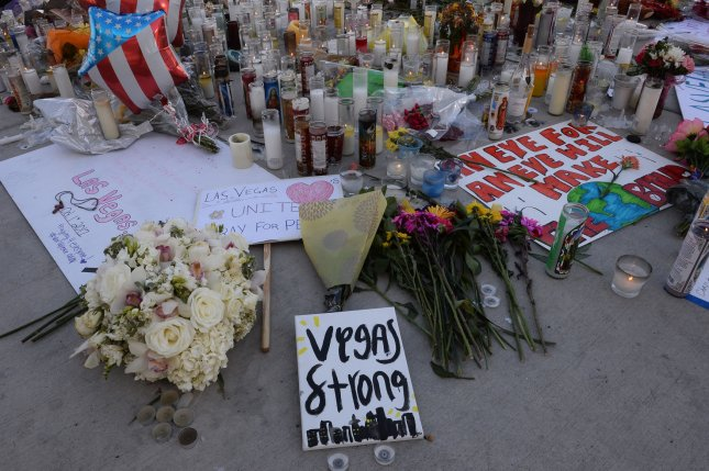 A makeshift memorial for the victims of the country music festival mass shooting appears on the northwest corner of Sahara and Las Vegas Blvds. in Las Vegas on Tuesday -- near where 58 people were killed and hundreds injured late Sunday at an outdoor country music festival. Photo by Jim Ruymen/UPI