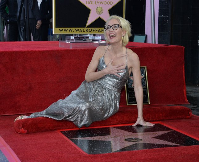 Gillian Anderson lies next to her star during an unveiling ceremony honoring her with the 2,625th star on the Hollywood Walk of Fame in Los Angeles on Monday. Photo by Jim Ruymen/UPI