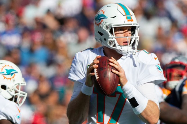 Miami Dolphins quarterback Ryan Tannehill drops back to pass during a game against the New England Patriots on September 30, 2018. Photo by Matthew Healey/UPI