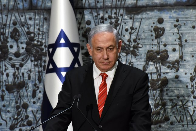 Israeli Prime Minister Benjamin Netanyahu speaks to reporters on September 25 after President Reuven Rivlin gave him a mandate to form the next coalition government. Photo by Debbie Hill/UPI