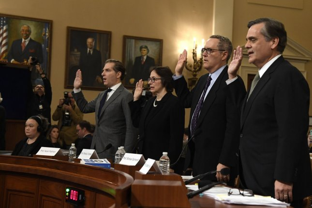 Law professors, from left to right, Noah Feldman, Pamela S. Karlan, Michael Gerhardt and Jonathan Turley are sworn in to testify before the House Judiciary Committee as part of the Donald Trump impeachment inquiry on Wednesday. Photo by Mike Theiler/UPI