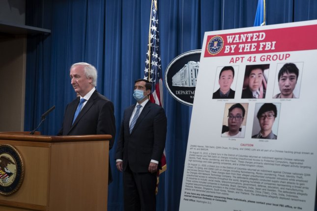 Deputy Attorney General Jeffery A. Rosen details charges laid against five Chinese nationals accused of hacking more than 100 companies at the Department of Justice in Washington, D.C., on Wednesday. Photo by Tasos Katopodis/UPI