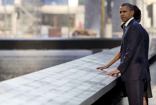 President Barack Obama and First Lady Michelle Obama visit the North Memorial Pool at Ground Zero on the 10th anniversary of the September 11 terrorist attacks on September 11, 2011 in New York. The President and First Lady are attending the Commemoration Ceremony at the National September 11 Memorial at the World Trade Center Site as they visit each of the three sites that were attacked. UPI/Kristoffer Tripplaar/Pool