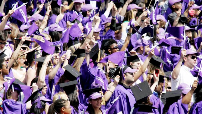 Graduates cheer as over 5,000 students participate in New York University's commencement exercise held at Yankee Stadium on May 13, 2009 in New York. The class of 2012 can look forward to an improved job market this year. (UPI Photo/Monika Graff)