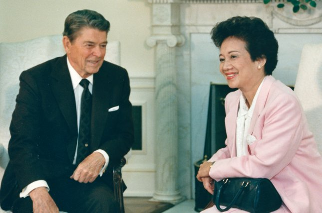 President Ronald Reagan and Philippine President Corazon Aquino meet on September 17, 1986, in the Oval office of the White House in Washington. Earlier in the year, U.S. lawmakers worked with the Aquino's administration to review documents possibly linking former leader Ferdinand Marcos to a scheme to channel wealth out of the country. File Photo by Ron Bennett/UPI
