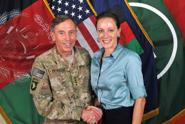 Former CIA Director David Petraeus with his biographer Paula Broadwell in 2011. Petraeus is pleading guilty to mishandling classifed information by sharing it with Broadwell.affair. File Photo by ISAF/UPI