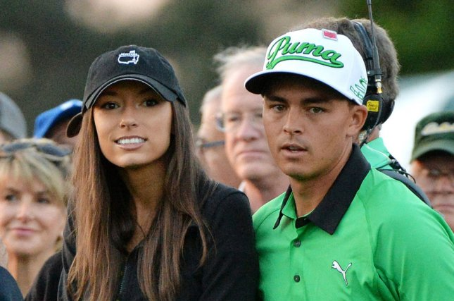 Rickie Fowler (R) and girlfriend Alexis Randock at Augusta National Golf Club in April 2015. File photo by Kevin Dietsch/UPI