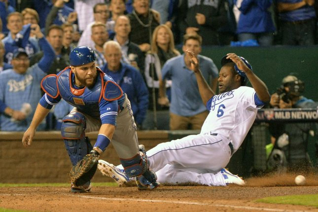 Kansas City Royals center fielder Lorenzo Cain (R) scores from first base on a single by teammate Eric Hosmer against Toronto Blue Jays catcher Russell Marting during the eighth inning in the ALCS game 6 at Kaufman Stadium in Kansas City on October 23, 2015. Photo by Kevin Dietsch/UPI