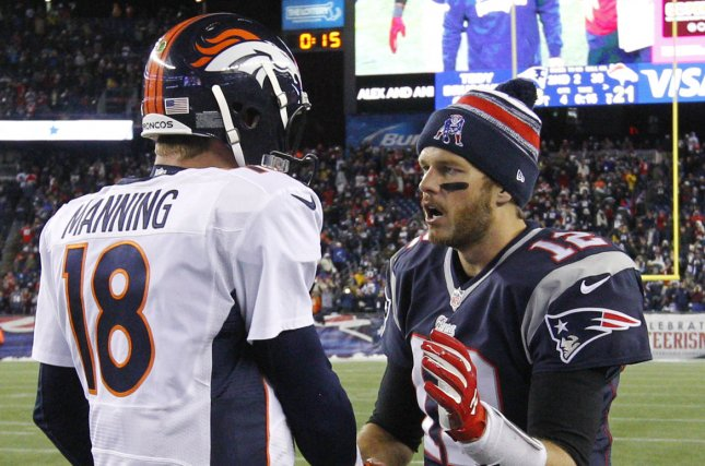 Denver Broncos quarterback Peyton Manning (18) shakes hands with New England Patriots quarterback Tom Brady (12). File photo Matthew Healey/UPI