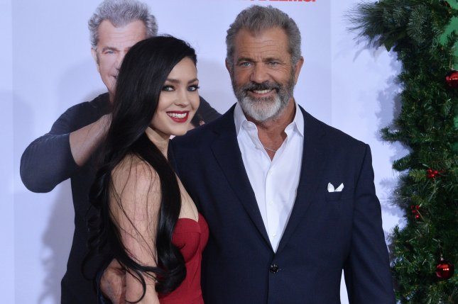 Mel Gibson (R) and his girlfriend Rosalind Ross. Gibson will be directing a World War II film titled Destroyer. File Photo by Jim Ruymen/UPI