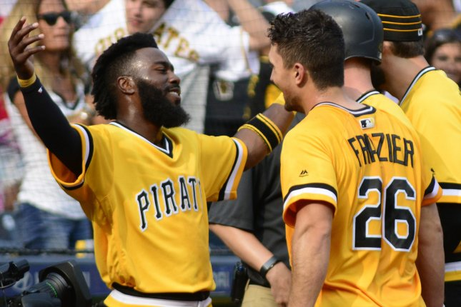 Pittsburgh Pirates second baseman Josh Harrison (5) embraces Pittsburgh Pirates second baseman Adam Frazier (26) after his walk off home run in the 11th inning to defeat the Chicago Cubs 2-1 on Sunday at PNC Park in Pittsburgh. Photo by Archie Carpenter/UPI
