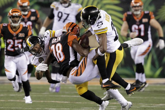 Cincinnati Bengals wide receiver A.J. Green (18) is tackled by Pittsburgh Steelers cornerback Artie Burns (25) during the second half of play on December 4, 2017 at Paul Brown Stadium in Cincinnati. Photo by John Sommers II/UPI