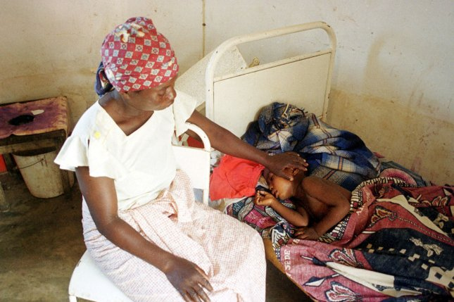 Gloria Tutsawambe, a resident of Sabie, a town north of Maputo, Mozambique, nurses her four-year-old son who is infected with malaria in March 2000. Photo by Renga Subbiah/UPI