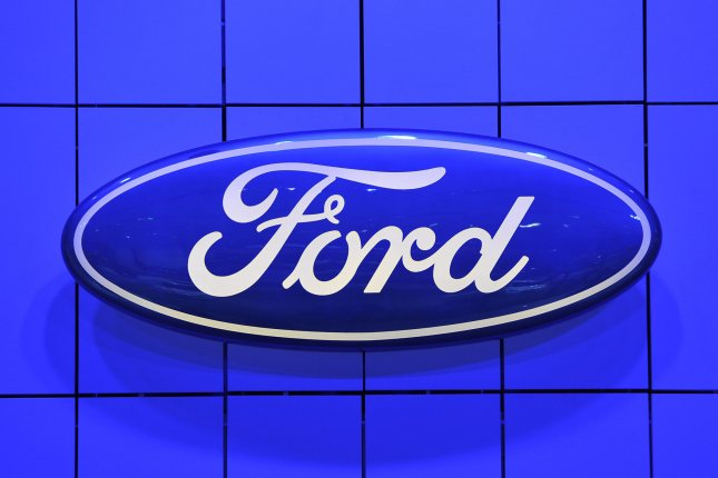 The Ford logo is displayed at the 2013 North American International Auto Show in Detroit on January 14, 2013. Ford said its new compact pickup, the Maverick, gathered 36,000 reservations in its first week. Photo by Brian Kersey/UPI