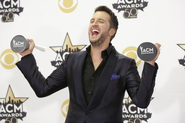 Luke Bryan pose backstage with the awards for Entertainer of the Year and Vocal Event of the Year at the 50th annual Academy of Country Music Awards held at AT&T Stadium in Arlington, Texas on April 19, 2015. Photo by John Angelillo/UPI