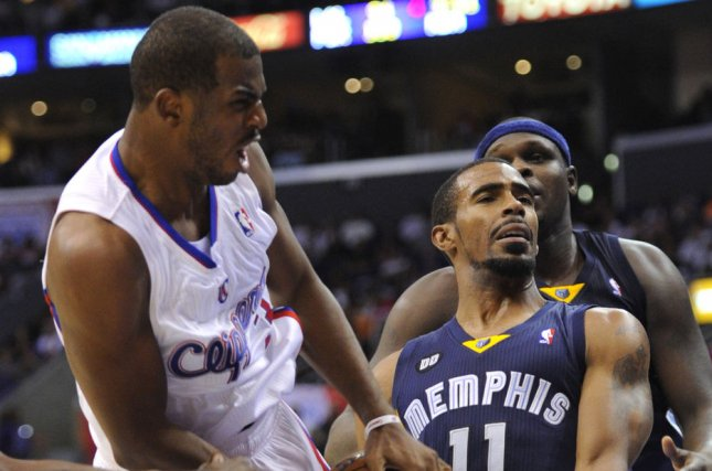 Los Angeles Clippers point guard Chris Paul (3) is fouled by Memphis Grizzlies point guard Mike Conley Jr. (11). UPI/Lori Shepler