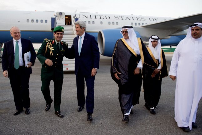 U.S. Secretary of State John F. Kerry walks with U.S. Embassy Riyadh Chief of Mission Timothy Lenderking and Saudi military and protocol officials after arriving at King Salman Air Base in Riyadh, Saudi Arabia, on April 20, 2016. Thursday, some lawmakers began acknowledging potential problems with the new law it passed Wednesday -- overriding President Barack Obama's veto -- that allows families of terror victims to sue foreign governments shown to sponsor terror. The White House called it a classic case of rapid onset buyer's remorse. File Photo by U.S. Department of State/UPI