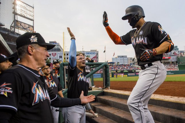 Miami Marlins right fielder Giancarlo Stanton (27) celebrates with teammates after hitting a two-run home run in the third inning against the Washington Nationals at Nationals Park in Washington, D.C. on August 10, 2017. Photo by Kevin Dietsch/UPI