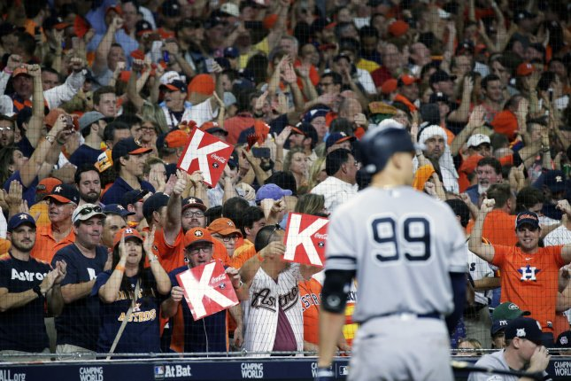 Houston Astros fans flash strikeout cards as New York Yankees' Aaron Judge strikes out to end the eighth inning against Houston Astros catcher Brian McCann in Game 7 of the American League Championship Series on October 21 at Minute Maid Park in Houston, Texas. File photo by John Angelillo/UPI