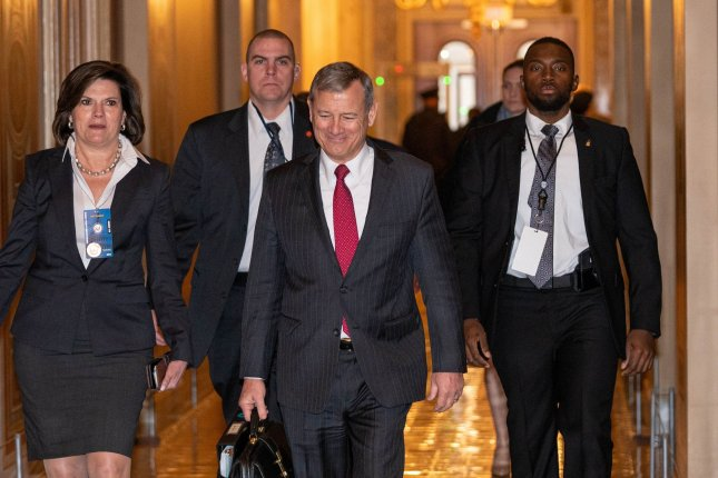 Chief Justice of the United States John G. Roberts walks into the U.S. Capitol Friday to preside over the fourth day of President Donald Trump's impeachment trial. Photo by Ken Cedeno/UPI