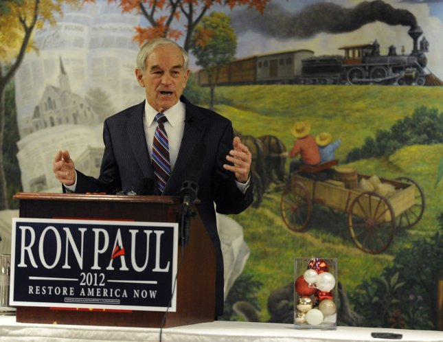 Republican 2012 presidential candidate and Texas Rep. Ron Paul makes remarks at a town hall meeting at the historic Hotel Pattee, as he campaigns in Perry, Iowa, December 29, 2011. Polls indicate a tight race between Paul, former Massachusetts Gov. Mitt Romney and former US House Speaker Newt Gingrich days before Iowa's first-in-the-nation caucuses, January 3,2012. UPI/Mike Theiler