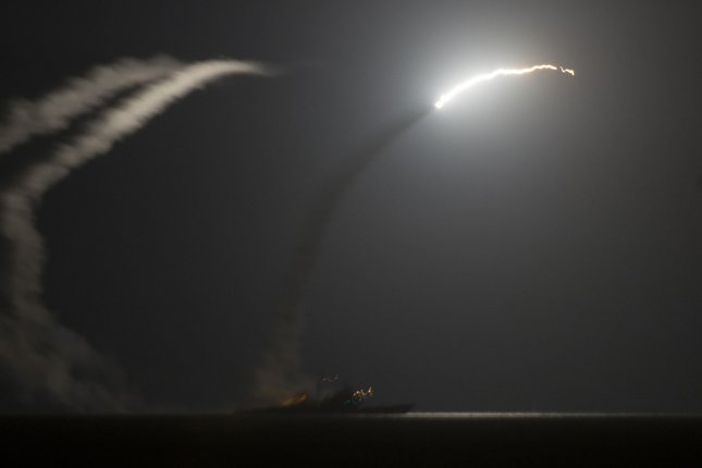 As seen from the aircraft carrier USS George H.W. Bush, the guided-missile cruiser USS Philippine Sea launches a Tomahawk cruise missile in the Arabian Gulf against Islamic State bases in Syria on September 23, 2014. UPI/Eric Garst/U.S. Navy