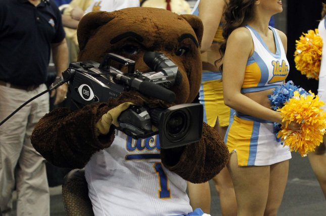 UCLA Bruins' mascot helps out the CBS Camera Man before the start of their game against the UAB Blazers in their third round game of the 2015 NCAA Division I Men's Basketball Championship at the KFC Yum! Center in Louisville, Kentucky, March 21, 2015. Photo by John Sommers II/UPI