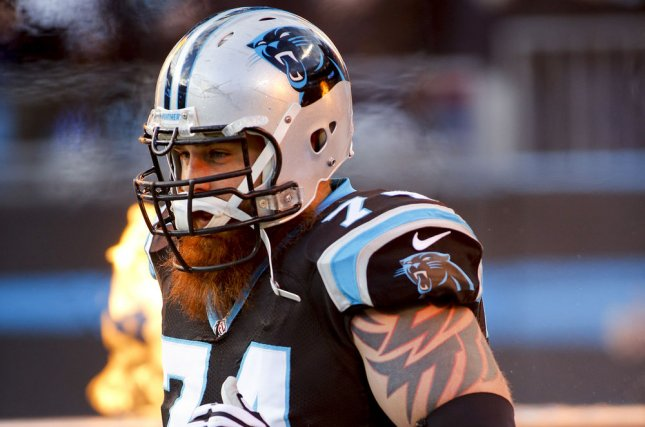 Carolina Panthers tackle Mike Remmers runs onto the field during player introductions before a game against the Tampa Bay Buccaneers in an NFL football game at Bank of America Stadium in Charlotte, North Carolina on January 3, 2016. UPI/Nell Redmond .