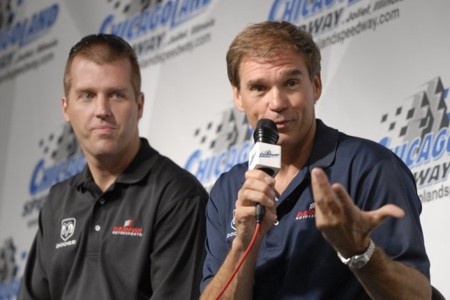 Jeremy Mayfield (L) listens as team owner Ray Evernham (R) speaks. File photo by Darrell Hoemann/UPI