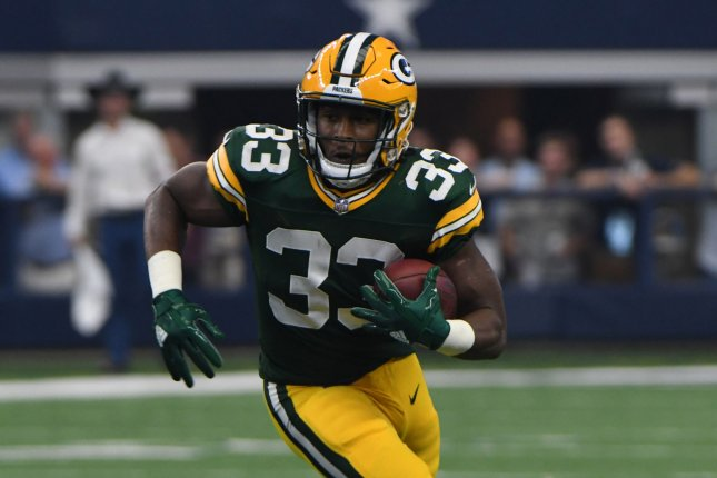 big sale f94ed 67d64 Aaron Jones: Green Bay Packers RB out for at least three ...