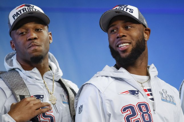 New England Patriots running back James White (28) smiles on stage before speaking to the media Monday at Super Bowl LII Opening Night at Xcel Energy Center in Minneapolis, Minn. Photo by Kamil Krzaczynski/UPI