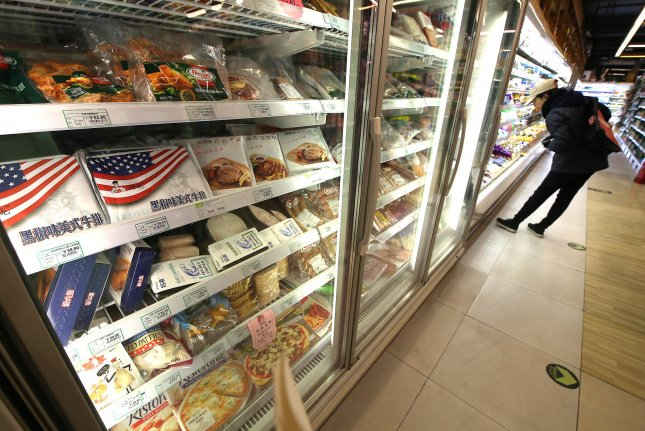 American pork is seen on sale at a grocery store in Beijing on April 3. Fiscal penalties from the United States and China took effect Friday, igniting what Beijing said is the largest trade war in economic history. File Photo by Stephen Shaver/UPI
