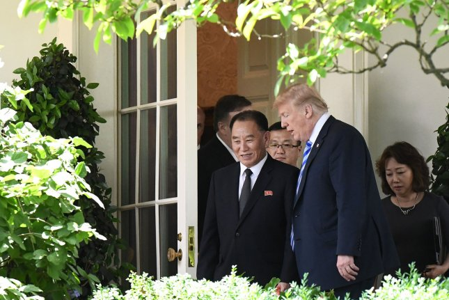 U.S. President Donald Trump walks with Kim Yong Chol (L), former North Korean military intelligence chief and one of leader Kim Jong Un's closest aides, outside the Oval Office of the White House in June. Kim is visiting the United States this week, according to multiple South Korean press reports. File Photo by Olivier Douliery/UPI